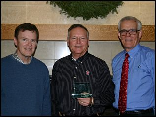 Bill Ryan and Dan Hill, nominators, Chuck Hill, center, recipient of WEECDA Distinguished Service Award